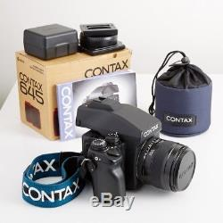Contax 645 Medium Format Camera kit with 80mm lens, film back, strap, and manual