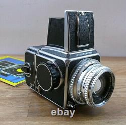 Hasselblad 500C with 80mm F2.8 Planar lens and 120 RF back. LN Condition