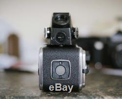 Hasselblad 500c/m film camera with metered finder Carl Zeiss 80mm and 2 A12 back