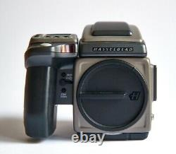 This Hasselblad H1 with Prism, 120 Film Back n Polaroid Back is in new condition